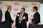 From left: A.R. Mullinax, Duke Energy; Ken Russell, SIM; award winner Josh Jewett, Family Dollar.