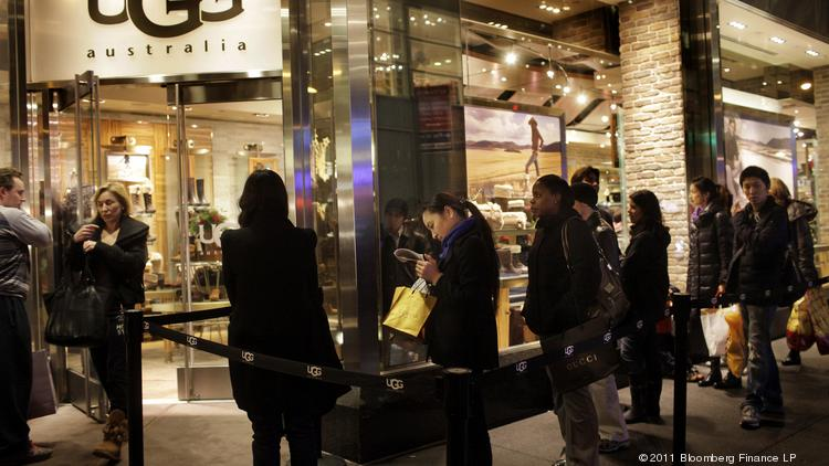 Holiday shoppers line up at an Ugg store on Fifth Avenue in Manhattan.
