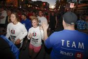 BMO Harris Bank employees urge on runners and walkers.