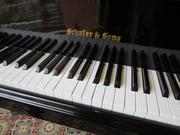 Also being sold, a Schafer & Sons grand piano.