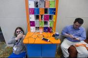 Attendees check their mobile phones at the South By Southwest Conference.