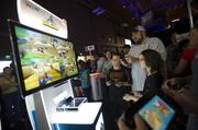 Attendees play Nintendo Co. Wii video games at the South By Southwest Conference.