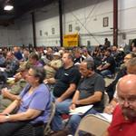 Auction draws 500 in person, 18,000 more online