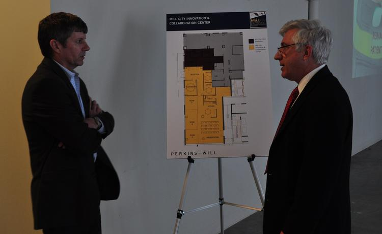 John Spohn of architecture firm Perkins & Will (left) talks with Dr. Kevin Peterson about plans for the Mill City Innovation & Collaboration Center.