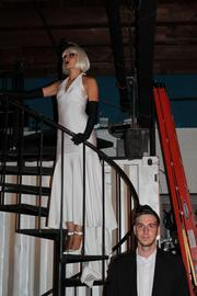C&I Studios Event Manager Corey Boost is at the foot of the spiral stairway where a second model signified the white part of the party theme.