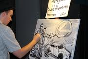 Artist Todd Traxler did a painting in front of attendees.