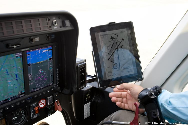 A helicopter pilot looks at his flight plan on an Apple ipad over Weehawken, N.J. (2011 photo)