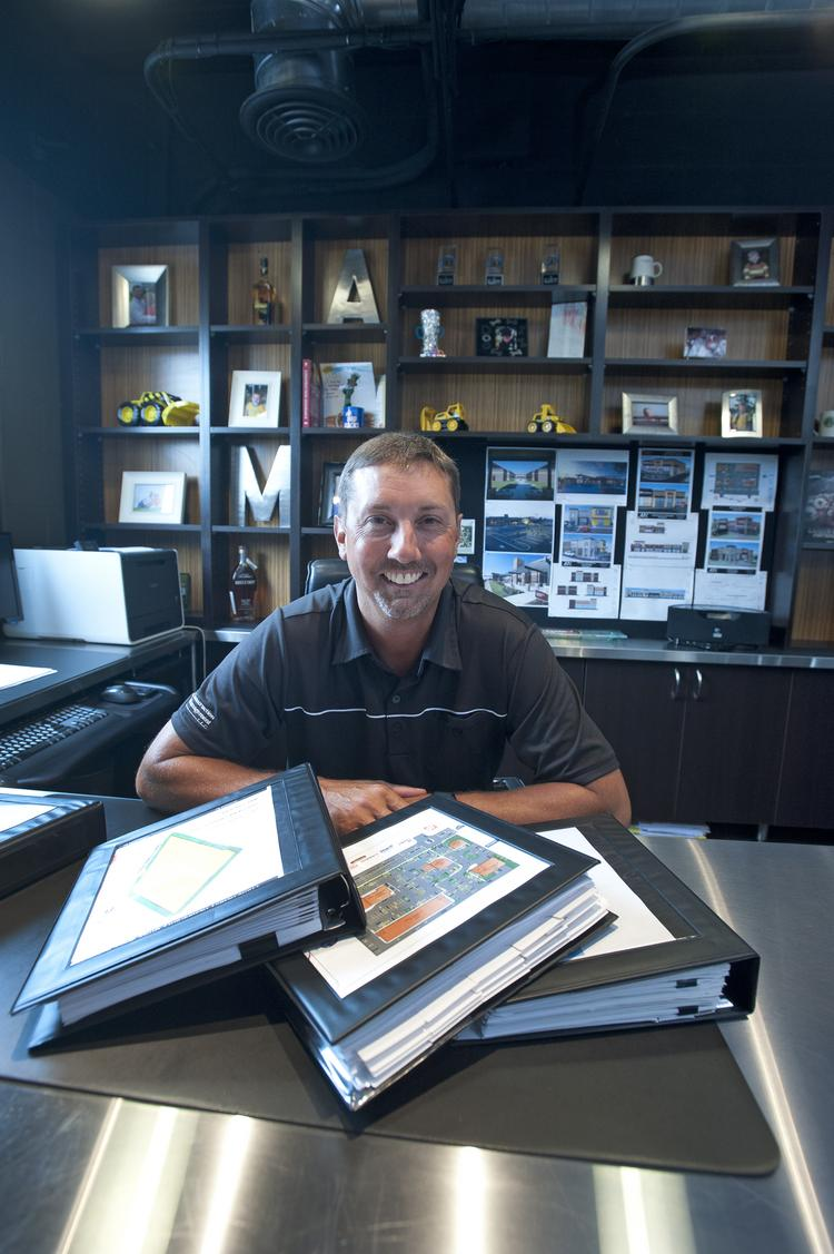 Alan Muncy, principal owner of ARC Construction Management LLC, maintains extensive binders for  his company's projects.