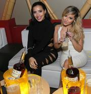 TV star and singer Adrienne Bailon, right, with actress and model Julissa Bermudez.