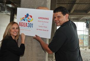 Amanda and Stephen Briggs with their just-designed logo for Agua 301, set to open in the Capitol Riverfront neighborhood this summer.