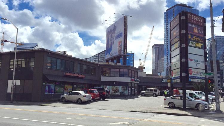 Bosa Properties has filed plans to build a large mixed-use project with 450 residential units on this property at Denny Way and Fairview Avenue.