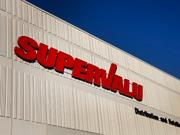 Supervalu executives cashed out after the company's January deal to spin off several chains.