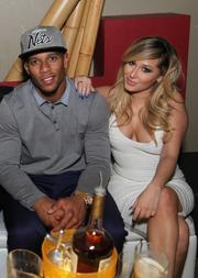 New York Giants' star Victor Cruz with singer and TV star Adrienne Bailon.