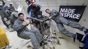 Noah Paul-Gin (left), Microgravity Experiment Engineering Lead, tests three Made in Space 3-D printers in microgravity with team members Jason Dunn (center) and Mike Chen.