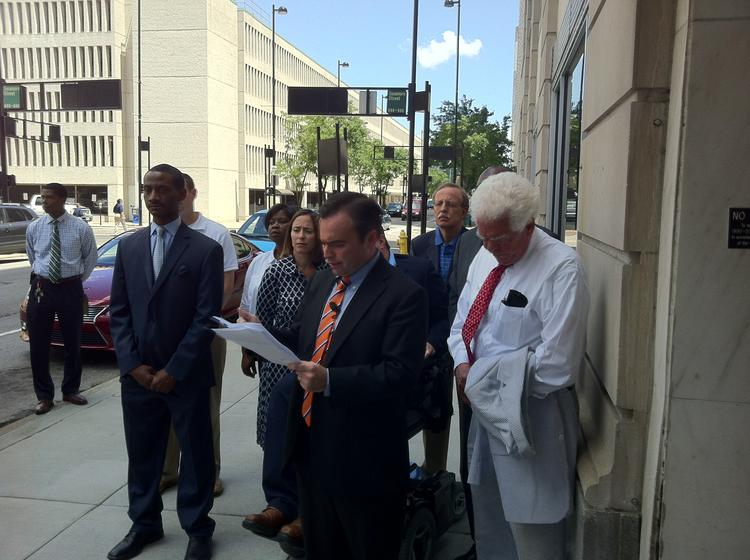 John Cranley holds a press conference about his opposition to the parking lease at 299 E. Sixth St. on Monday afternoon.