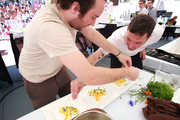 Genoa Executive Chef Jake Martin, right, and sous chef Matt Elswick race to finish what they called the perfect summer salad. Time ran out before they could finish adding the garnish.
