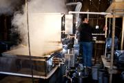 The temperature of the evaporator is checked in the sugar shack at Richards Maple Products.
