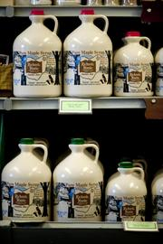 Bottles of maple syrup sit on display in the retail shop at Richards Maple Products.