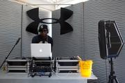 Talib Kweli spins during the Under Armour Kicks & Grits party.