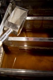 Maple sap sits in an evaporator waiting to be boiled and made into Maple Syrup in the sugar shack at Richards Maple Products.