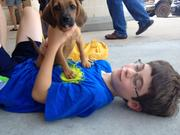 Ian Aguilar, 8, bonds with a puppy for adoption.