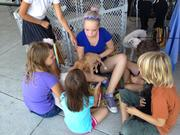 Trisha Berry of the Faith Phee & Butterbee Foundation in Houston shows area children some of the puppies available for adoption.
