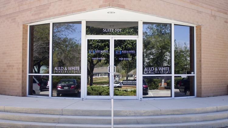 The owners of Auld & White Constructors LLC have announced they will begin to turn day-to-day operations over to two longtime employees within the company.