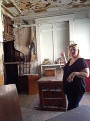 Terry O'Brien shows some of the deterioration inside the former Trojan Hotel in downtown Troy