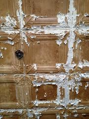 The original tin ceiling in one room of the former Trojan Hotel that will open in the fall as O'Brien's Public House