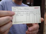 A close-up of the receipt written out to Don O'Brien's father, also named Don, on July 25, 1965, for a night at the old Trojan Hotel. The receipt was found amidst the debris inside the hotel.