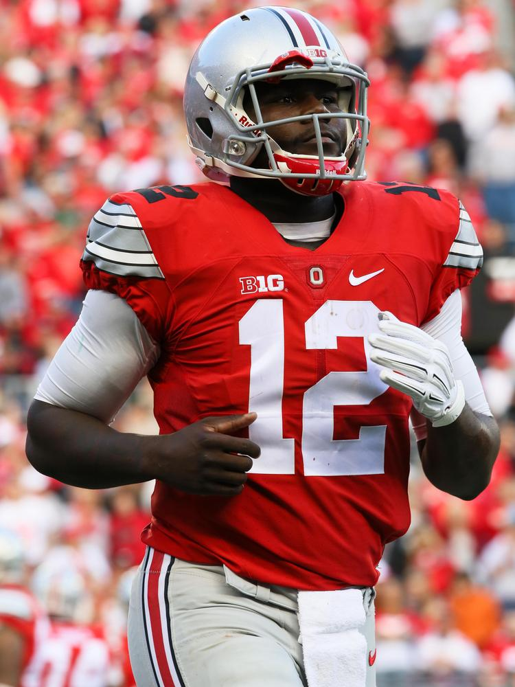055eceddc80 Nike's famous swoosh logo adorns Ohio State Buckeyes uniforms under a  sponsorship deal with the apparel