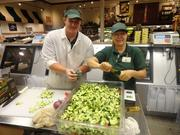 Jarrod Webster, assistant deli manager of Fresh Market's Knoxville, Tenn., store, and Debra Barley, Fresh Market certified trainer, prepare dilly cucumber salad.