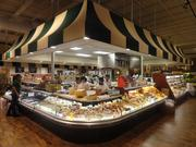 The center of the Fresh Market store features a deli counter.