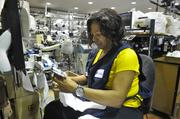 After socks are knit, Donna White, a modular operator for Thorlo Inc., takes them to the final step -- closing the toes with a seam.