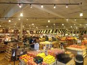 Fresh Market workers prepare the floor for the grand opening of the West Holcombe store.