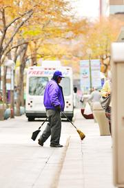 Marcelo Lobato, assistant to the supervisor at the Business Improvement District, works on the 16th Street Mall in November 2011.
