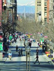 Pedestrian traffic increases on the mall, near 16th and Broadway, with no shuttle service with RTD employees on strike in 2006.