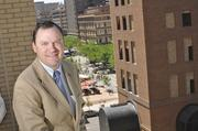 Marc Blackford, director of operations at the Westin Denver Downtown, with a view of the mall from the pool level at the hotel.