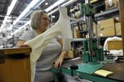 Karen Waters, who works in quality assurance for Thorlo Inc., measures the stretch parameters of each batch of socks.