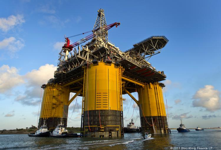 Shell, which has its new offshore platform pictured here, reported a significant decline in second quarter earnings.