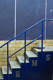 The former stairs to the auditorium stage still bear the initials HMS for Highlandtown Middle School.