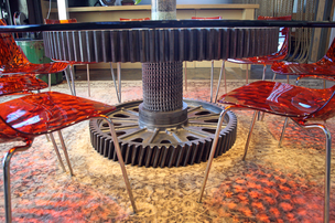 Designer Craig Bergman fashioned a conference room table at Citizen Inc. from industrial-sized gears