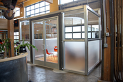 A private meeting room at Citizen Inc. The cage-like walls lift away when needed.