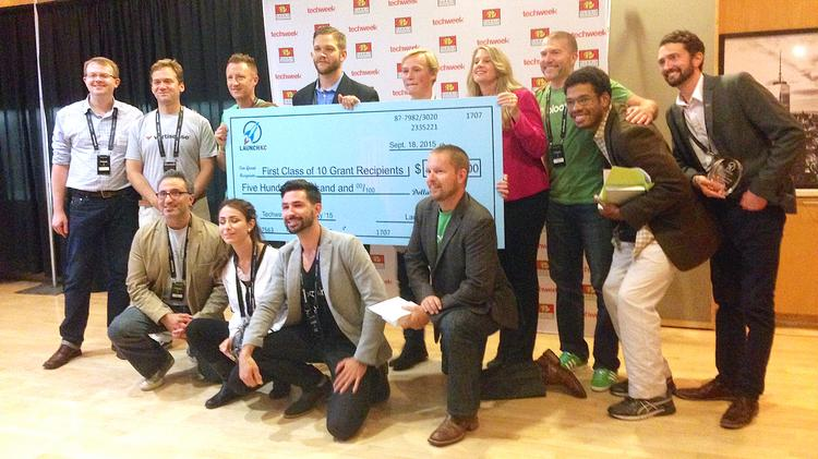 Winners of the LaunchKC global grants competition were all smiles Friday. The tech startups will each receive $50,000, one free year of office space in downtown Kansas City and other perks.