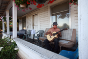 Monday, 7:15 p.m.: Antoni Colin plays his prized guitar he bought in Tijuana, Mexico. He is truly a master and belted out several Spanish songs as his fingers glided over the strings on this hot summer evening.