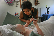 Monday, 10:45 a.m.: House call provider nurse Amy Long checks in on a longtime client now in hospice care. It was a caring conpassionate and moving moment.