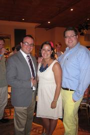 From left, Chris4Life Executive Director Michael Sapienza; Kirstin Adams, one of Erica's best friends; and Michael Paul, Erica's husband.