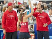 The Washington Kastles set a national record among professional sports teams on July 9 when the team beat the Boston Lobsters 25-12, their 34th win in a row. Martina Hingis gives teammate Bobby Reynolds a high-five.