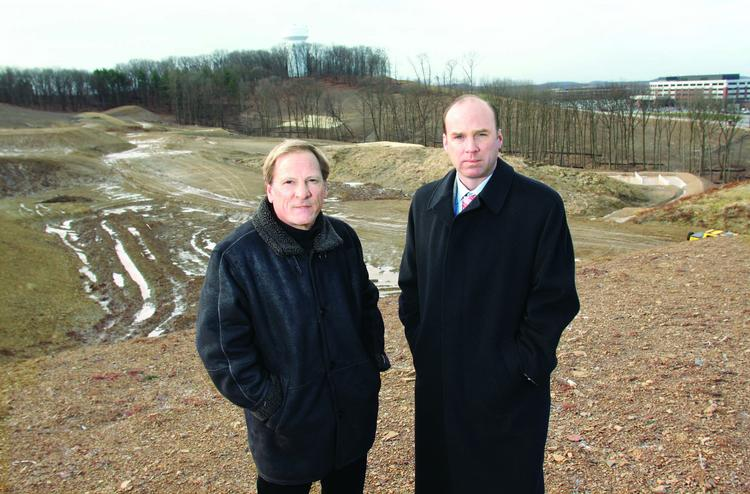 Creative Real Estate principal Don Rodgers, left, and Jason Stewart, excutive vice president, Director of Agency Leasing for Jones Lang LaSalle, stand on-site in January 2012 at The Summit of Cranberry Woods.