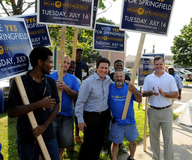 MGM president Bill Hornbuckle and MGM CEO Jim Murren gather with supporters in Springfield on July 16. Voters that day approved MGM's plan for an $800 million resort casino in the city's South End.